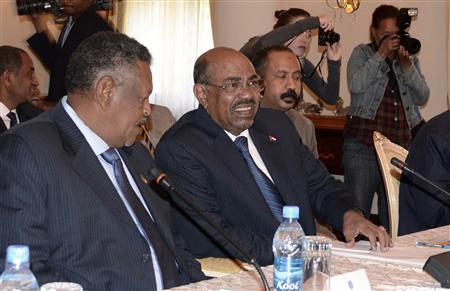 Sudan's President Omar Hassan al-Bashir (C) speaks during a meeting with leaders from South Sudan at the National Palace in the Ethiopian capital Addis Ababa January 5, 2013. The leaders of Sudan and South Sudan met late on Friday to try to defuse hostility that has simmered since the south broke away in 2011 and restart cross-border oil flows to rescue their crumbling economies. REUTERS/Tiksa Negeri