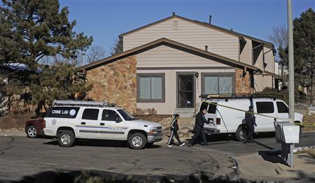 Police continue their investigation outside a townhouse complex following an overnight hostage-taking incident in Aurora, Colorado January 5, 2013. REUTERS/Evan Semon