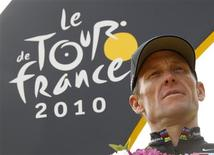 "Radioshack team rider Lance Armstrong of the U.S. poses on the podium in Paris after the final 20th stage of the 97th Tour de France cycling race between Longjumeau and Paris in this July 25, 2010 file photo. Armstrong, the disgraced American cyclist at the center of the biggest doping scandal in the sport's history, may admit he used performance-enhancing drugs during his career, the New York Times reported in editions on January 5, 2013, citing ""several people with direct knowledge of the situation."" The newspaper said Armstrong, 41, has told associates and anti-doping officials he may make the admission in hopes of persuading anti-doping officials to allow him to resume competition in athletic events that adhere to the World Anti-Doping Code, under which Armstrong is currently subject to a lifetime ban. REUTERS/Eric Gaillard/Files"