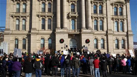 Protesters gathered in front of the of the Jefferson County Courthouse in Steubenville, Ohio, January 5, 2013. A county sheriff under fire for how he has handled a high school rape investigation faced down a raucous crowd of protesters on Saturday, telling critics no further suspects would be charged in a case that has rattled Ohio football country. REUTERS/Drew Singer