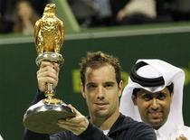 France's Richard Gasquet holds up his trophy after he won the final against Nikolay Davydenko of Russia at the Qatar Open in Doha January 5, 2013. REUTERS/ Jamal Saidi