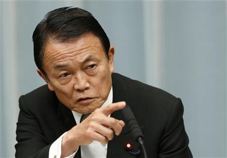 Japan's Finance Minister Taro Aso speaks at a news conference in Tokyo December 27, 2012. REUTERS/Kim Kyung-Hoon