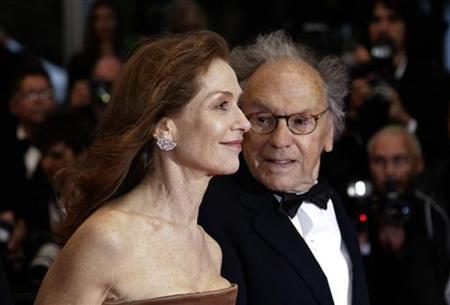 Cast members Isabelle Huppert (L) and Jean-Louis Trintignant (R) arrive on the red carpet for the screening of the film ''Amour'', by director Michael Haneke in competition at the 65th Cannes Film Festival, May 20, 2012. REUTERS/Eric Gaillard