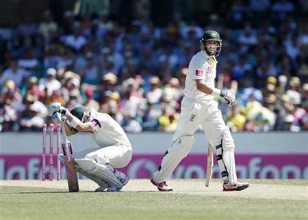 Australia's captain Michael Clarke (L) reacts as team mate Mike Hussey leaves the field after being run out during the second day's play of the third test cricket match against Sri Lanka at the Sydney Cricket Ground January 4, 2013. REUTERS/Tim Wimborne
