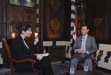 Bachar al Assad lors d'un entretien accordé à la chaîne russe Russia Today, en novembre dernier. Le président syrien va effectuer dimanche sa première apparition télévisée depuis cette date, quelques jours après que les Nations Unies ont fait état de 60.000 tués depuis le début en mars 2011 du conflit entre le gouvernement et les insurgés. /Image diffusée le 9 novembre 2012/REUTERS/Sana