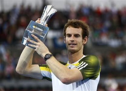 Andy Murray of Britain poses with the trophy after defeating Grigor Dimitrov of Bulgaria in their men's final match at the Brisbane International tennis tournament January 6, 2013. REUTERS/Daniel Munoz
