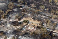 The debris of houses destroyed by a bushfire is seen in Dunalley, about 40 kilometres (25 miles) east of Hobart, January 5, 2013. REUTERS/Chris Kidd/Pool