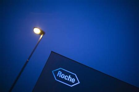 A logo of Swiss pharmaceutical company Roche is pictured in front of a company's building in Rotkreuz, April 12, 2012. Swiss drugmaker Roche said it would have to rethink its tactics if shareholders of reluctant U.S. bid target Illumina did not back its approach as it reported strong first-quarter pharmaceutical sales helped by top cancer drugs. REUTERS/Michael Buholzer (SWITZERLAND - Tags: BUSINESS LOGO HEALTH)