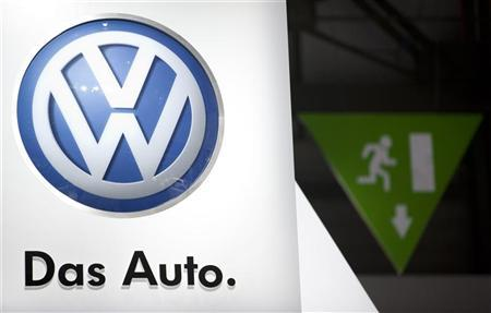 A Volkswagen logo is seen next to an emergency exit sign on the company's booth during the first media day of the Geneva Auto Show at the Palexpo in Geneva, March 6, 2012. REUTERS/Valentin Flauraud