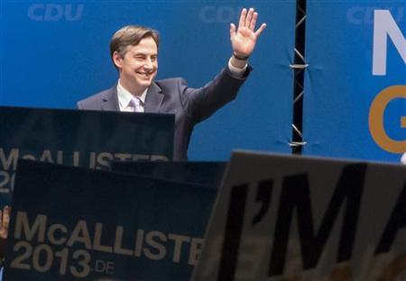 Lower Saxony federal state premier and top candidate of the Christain Democratic Union (CDU) in the federal state elections David McAllister, waves as he prepares for his speech during the CDU's initial election campaign event in Brunswick, January 5, 2013. A regional election will be held on January 20 in Lower Saxony state, with Merkel's conservatives fighting to prevent a loss of local power to their Social Democrat rivals that could dent the chancellor's 2013 re-election hopes. REUTERS/Morris Mac Matzen (GERMANY - Tags: POLITICS ELECTIONS)