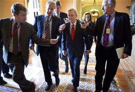 Senate Minority Leader Mitch McConnell (R-KY) (C) walks with reporters on the opening day of the 113th Congress on Capitol Hill in Washington on January 3, 2013. REUTERS/Joshua Roberts