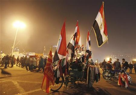 Egyptian flags are displayed for sale during New Year's Eve celebrations at Tahrir Square, where protesters opposing President Mohamed Mursi are camping, in Cairo December 31, 2012. REUTERS/Amr Abdallah Dalsh (EGYPT - Tags: POLITICS CIVIL UNREST ANNIVERSARY SOCIETY)