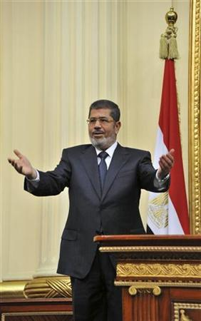 Egyptian President Mohamed Mursi gestures before delivering a speech to the Shura Council, or upper house of parliament, in Cairo December 29, 2012. REUTERS/Egyptian Presidency/Handout/Files