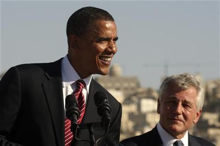 President Barack Obama (L) smiles next to Chuck Hagel (R-NE) during a news conference at the Amman Citadel, an ancient Roman landmark, in Amman, Jordan, July 22, 2008. REUTERS/Ali Jarekji