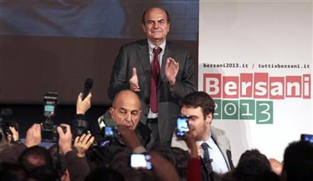 Democratic Party (PD) leader Pier Luigi Bersani celebrates his victory in downtown Rome December 2, 2012. Bersani won a run-off primary election by a huge margin on Sunday to become the Italian centre-left candidate for prime minister in national elections early next year. REUTERS/ Stringer