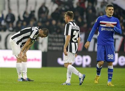 Sampdoria's Mauro Emanuel Icardi (R) reacts at the end of the match against Juventus during his Italian Serie A match at the Juventus stadium in Turin January 6, 2013. REUTERS/Giorgio Perottino