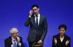 Leader of Germany's Free Democratic party (FDP) Philipp Roesler (C) adjusts his glasses as he stands between faction leader Rainer Bruederle (L) and Vice Chairman Birgit Homburger during the traditional FDP epiphany meeting in Stuttgart January 6, 2013. With its novice leader under fire, the liberal, pro-business party meets in Stuttgart this weekend to try to stop the rot before a general election that could wipe it out. Much of the FDP's internal strife centres on 39-year-old Vietnamese-born leader Philipp Roesler, whose attempt to inject new dynamism on taking over in May 2011 failed spectacularly. REUTERS/Ralph Orlowski