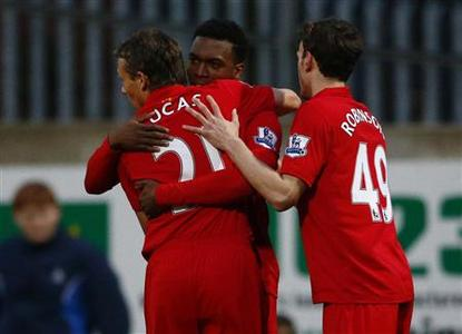 Liverpool's Daniel Sturridge (C) celebrates with Lucas Leiva (L) and Jack Robinson after scoring during their FA Cup third round soccer match against Mansfield Town at Field Mill in Mansfield, central England, January 6, 2013. REUTERS/Darren Staples