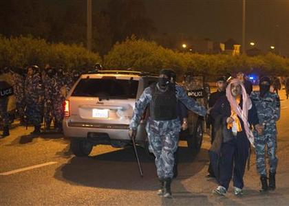 Kuwait Police Special Forces arrest an illegal demonstrator during a protest in Kuwait City January 6, 2013. Security forces used stun grenades to disperse hundreds of opposition activists trying to stage a march in Kuwait on Sunday, part of a series of protests against what they see as a rubber-stamp parliament, and made several arrests. Witnesses said between 200 and 300 people had barely gathered in an affluent suburb of Kuwait City late on Sunday when security forces ordered them to disperse because their rally was not licensed. REUTERS/Stephanie Mcgehee