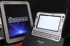 Panasonic Toughpad (L) and handheld Toughbook model are displayed at the company's IT products headquarters in Moriguchi, western Japan December 7, 2012. Panasonic Corp's answer to the brutal onslaught on its TV sales may be in a product the Japanese firm launched 17 years ago and which is a must-have for U.S. police cars. Two thirds of the 420,000 patrol cars in the United States are equipped with the company's rugged Toughbook computers, and Panasonic chief Kazuhiro Tsuga sees the niche product as a model for how the sprawling conglomerate can make money beyond a gadget mass market increasingly dominated by Samsung Electronics and Apple Inc. Picture taken December 7, 2012. REUTERS/Tim Kelly