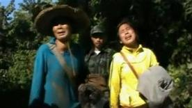 Evacuees react after being received by Kachin's soldiers in Kachin state in this still image taken from a video dated December 28, 2012. REUTERS/Courtesy of Democratic Voice of Burma/Handout
