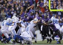Indianapolis Colts kicker Adam Vinatieri kicks a field goal through the arms of the Baltimore Ravens during the first half of their NFL AFC wildcard playoff game in Baltimore January 6, 2013. REUTERS/Gary Cameron