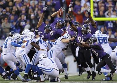 NFL: Ravens pound Colts, earn playoff date with...
