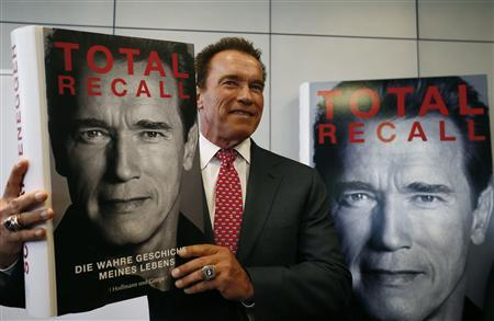 Actor and former California governor Arnold Schwarzenegger presents his book 'Total Recall' during a news conference during the book fair in Frankfurt, in this October 10, 2012 file photo. A year after leaving the California governor's office and becoming tabloid fodder for fathering a boy with his family's housekeeper and splitting with his wife, Maria Shriver, the 65-year old former bodybuilder will star in no less than three Hollywood movies over the next 12 monthsREUTERS/Ralph Orlowski/Files