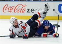 Washington Capitals' Marcus Johansson (L) is knocked to the ice by a sliding New York Rangers' Anton Stralman in the second period during Game 1 of their NHL Eastern Conference semi-final playoff hockey game at Madison Square Garden in New York, April 28, 2012. REUTERS/Ray Stubblebine