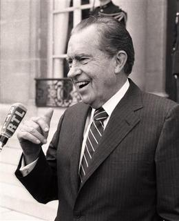 Former US President Richard Nixon speaks at the Elysee Presidential Palace in Paris, in this May 20, 1987 file photo. Nixon, a divisive figure in U.S. politics who became the only sitting president ever to leave office when he resigned over the Watergate scandal, would be turning 100 years old this week if he were alive. REUTERS/Jean-Claude Delmas/files
