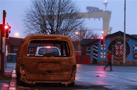 A burnt out car blocks part of Tempelmore Avenue in east Belfast January 6, 2013. REUTERS/Cathal McNaughton