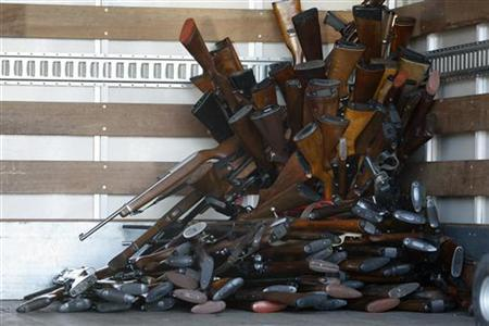 A small portion of guns that were turned in by their owners are stacked inside a truck at a gun buyback held by the Los Angeles Police Department in Los Angeles, California, December 26, 2012 following the mass shooting at Sandy Hook Elementary School in Connecticut. REUTERS/David McNew