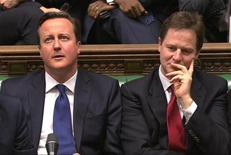 Britain's Prime Minister David Cameron and Deputy Prime Minister Nick Clegg (R) listen to the opposition after Chancellor of the Exchequer George Osborne delivered the autumn budget in parliament in London December 5, 2012. REUTERS/UK Parliament