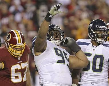 Seattle Seahawks defensive tackle Alan Branch (99) celebrates his second half sack on Washington Redskins quarterback Robert Griffin III (10), during their NFL NFC wildcard playoff game in Landover, Maryland, January 6, 2013. REUTERS/Laurence Kesterson