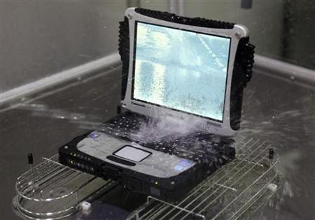 Panasonic's Toughbook computer undergoes water resistance testing at a factory of the company in Kobe, western Japan December 7, 2012. REUTERS/Tim Kelly/Files
