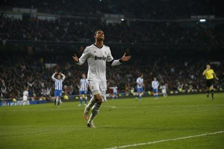 Real Madrid's Cristiano Ronaldo celebrates his goal during their Spanish first division soccer match against Real Sociedad at Santiago Bernabeu stadium in Madrid January 6, 2013. REUTERS/Juan Medina