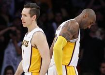 Los Angeles Lakers' Steve Nash (L) and Kobe Bryant walk on the court during the final minute of their loss to the Denver Nuggets during an NBA basketball game in Los Angeles January 6, 2013. REUTERS/Danny Moloshok