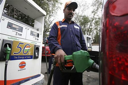 An employee fills a car with petrol at a gas station in Jammu February 26, 2010. REUTERS/Mukesh Gupta/Files