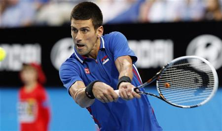 Novak Djokovic of Serbia hits a return to Fernando Verdasco of Spain during their men's singles match at the Hopman Cup tennis tournament in Perth January 5, 2013. REUTERS/Stringer