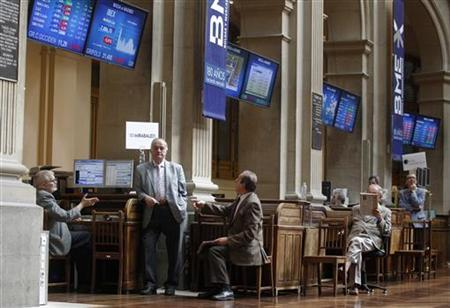 Traders talk at the stock exchange in Madrid July 6, 2012. REUTERS/Andrea Comas/Files