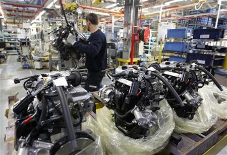 An employee at the Smart Cars factory is seen surrounded by engines as he works on the Smart Fortwo assembly line in Hambach, eastern France, December 11, 2012. REUTERS/Vincent Kessler