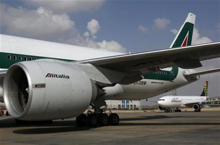 An Alitalia airplane is seen at the airport in Cairo January 20, 2011. Italy signed an agreement on Thursday with Egypt Air to carry out maintenance work for its Alitalia aircraft. REUTERS/Mohamed Abd El Ghany