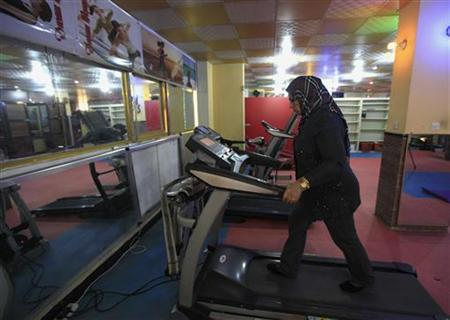 A woman works out on a treadmill at a gym in Baghdad December 2, 2012. REUTERS/Thaier al-Sudani/Files