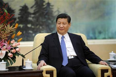 China's Communist Party chief Xi Jinping looks on during his meeting with U.N. General Assembly President Vuk Jeremic at the Great Hall of the People in Beijing December 27, 2012. REUTERS/Wang Zhao/Pool