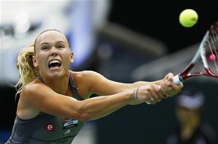 Denmark's Caroline Wozniacki hits a return against Australia's Samantha Stosur during their Kremlin Cup final tennis match in Moscow October 21, 2012. REUTERS/Grigory Dukor/Files