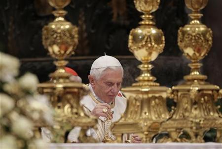 Pope Benedict XVI uses the incense burner as he leads the Epiphany mass in Saint Peter's Basilica at the Vatican January 6, 2013. REUTERS/Max Rossi