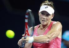 Samantha Stosur of Australia hits a return against Sofia Arvidsson of Sweden during their women's singles match at the Brisbane International tennis tournament December 31, 2012. REUTERS/Daniel Munoz