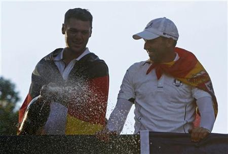 Team Europe golfers Martin Kaymer (L) of Germany and Sergio Garcia of Spain celebrate with champagne after winning the Ryder Cup during the 39th Ryder Cup singles golf matches at the Medinah Country Club in Medinah, Illinois, September 30, 2012. REUTERS/Jeff Haynes/Files