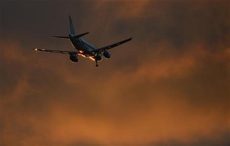 An Alitalia aircraft flies in to land at Heathrow Airport in west London October 14, 2012. REUTERS/Toby Melville