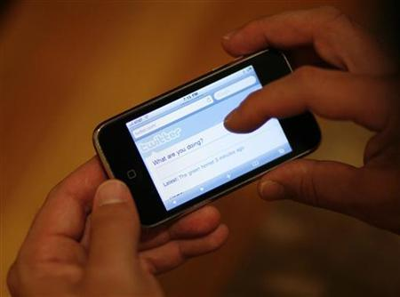 A Twitter page is displayed on an Apple iPhone in Los Angeles October 13, 2009. REUTERS/Mario Anzuoni/Files